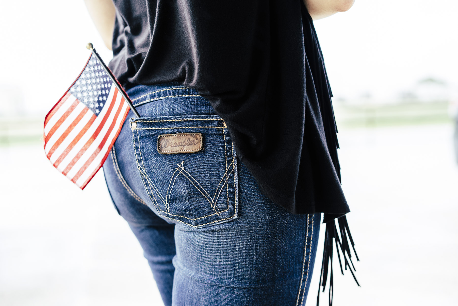 American Flag in back pocket of woman