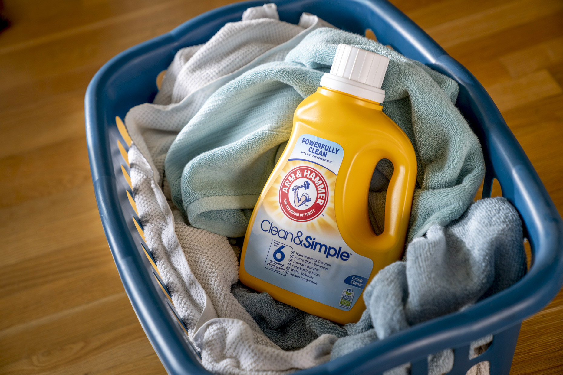 Arm and Hammer laundry soap in basket of towels