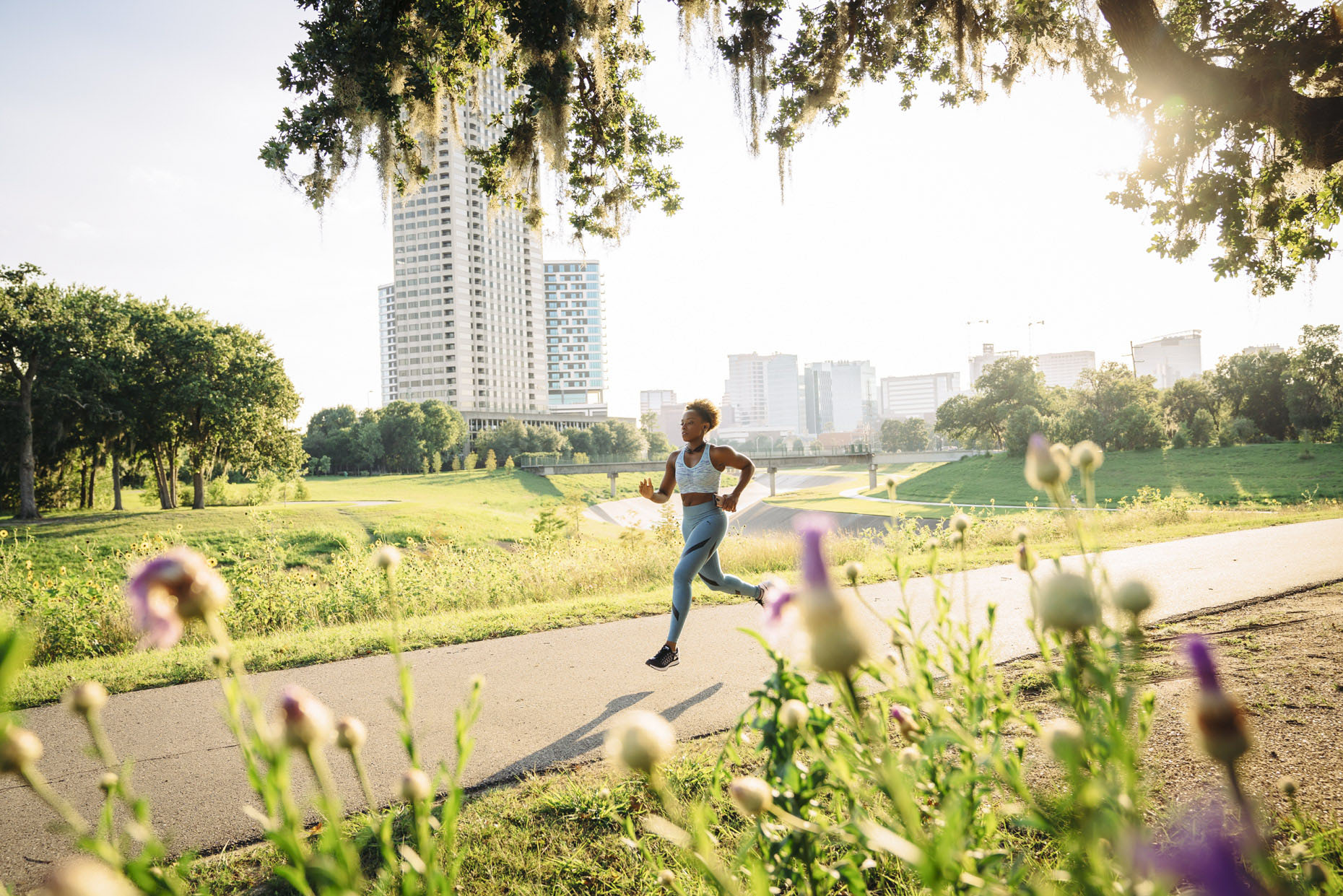 Black woman running in urban park