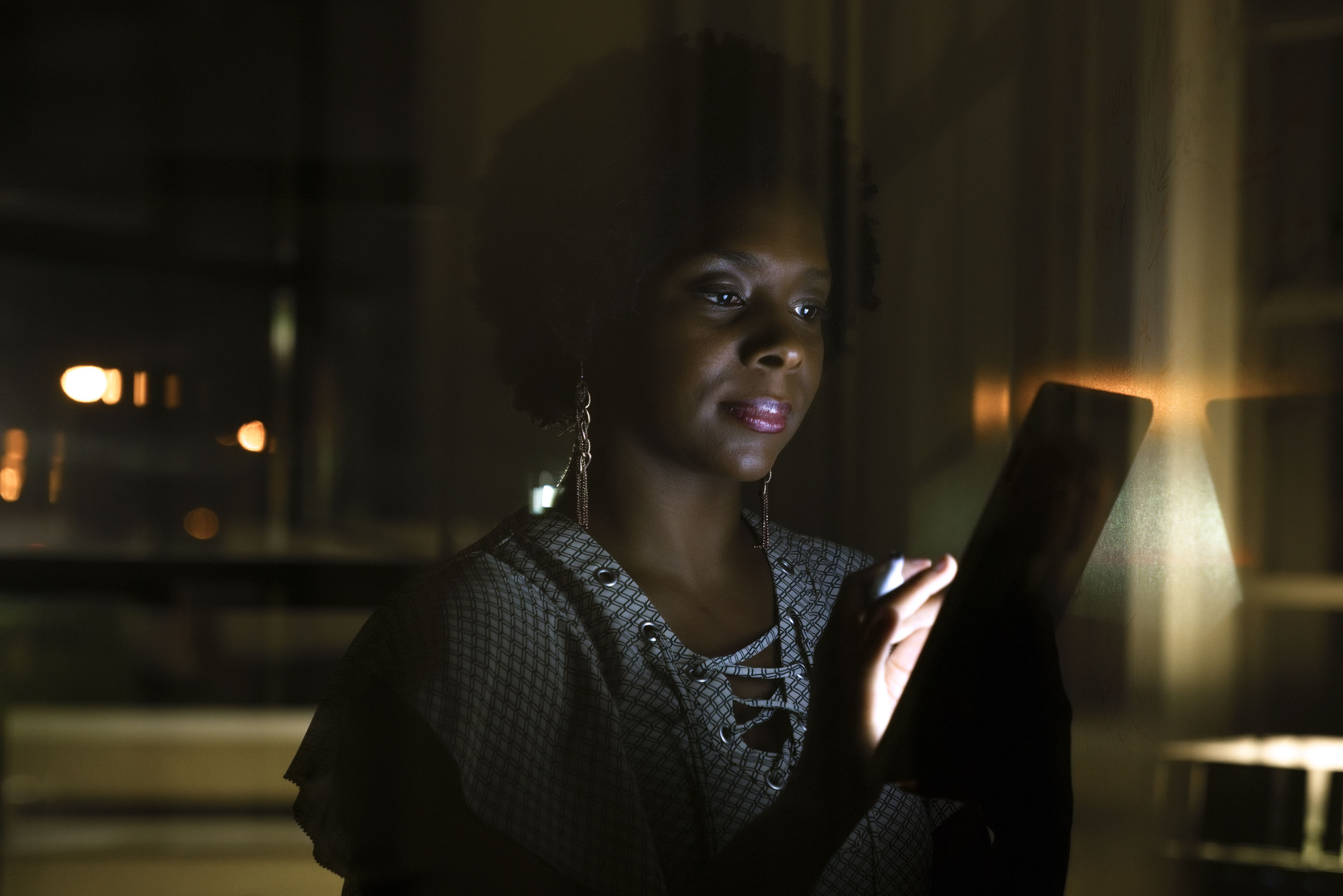 Black-woman-working-on-tablet-computer-at-night-Inti-St-Clair-LYDA_201703273114