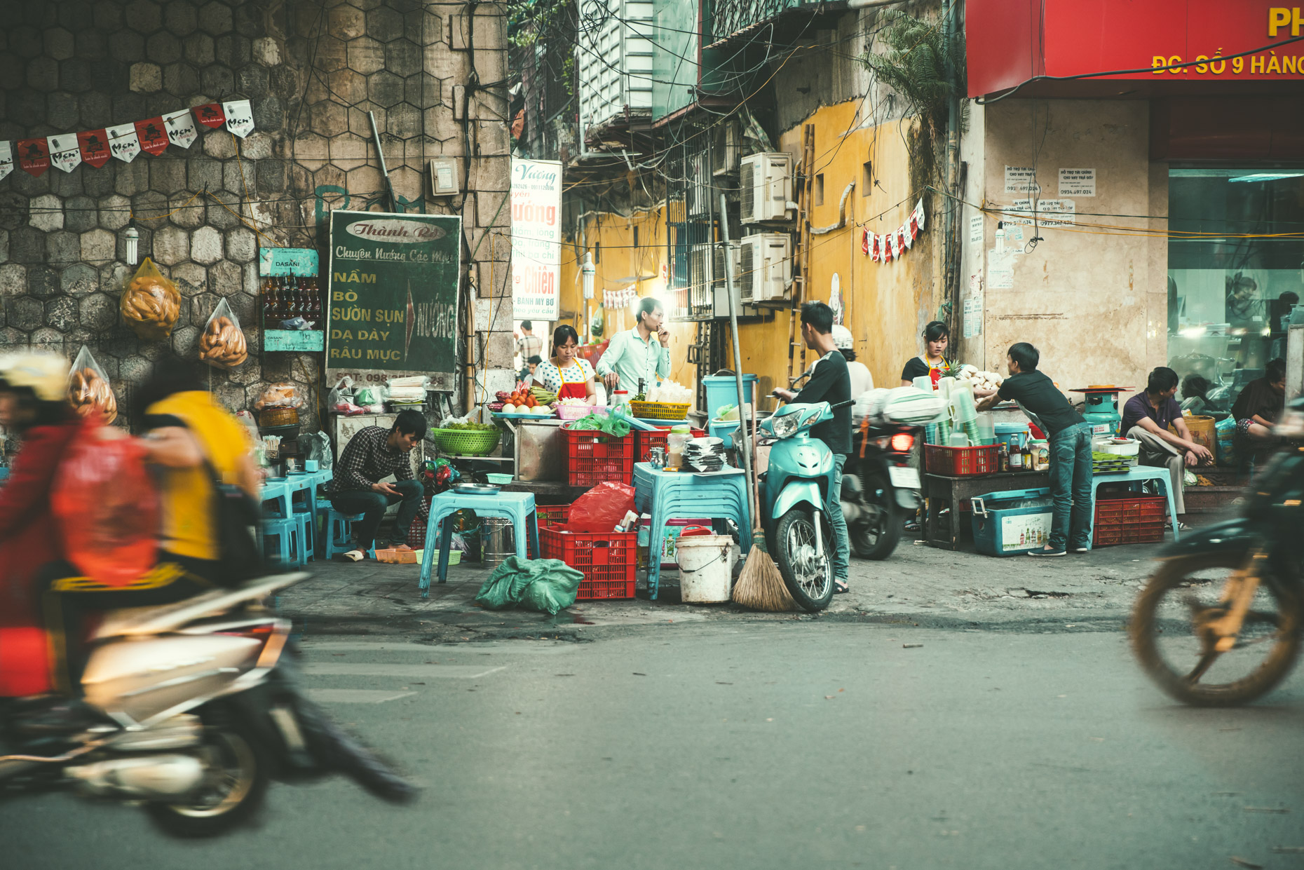 Busy street food vendors in Hanoi Vietnam