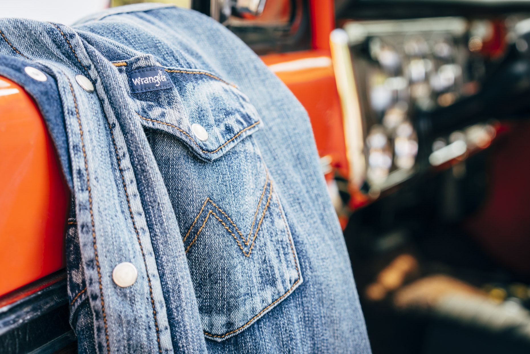 Close up of Wrangler Denim shirt hanging on truck door