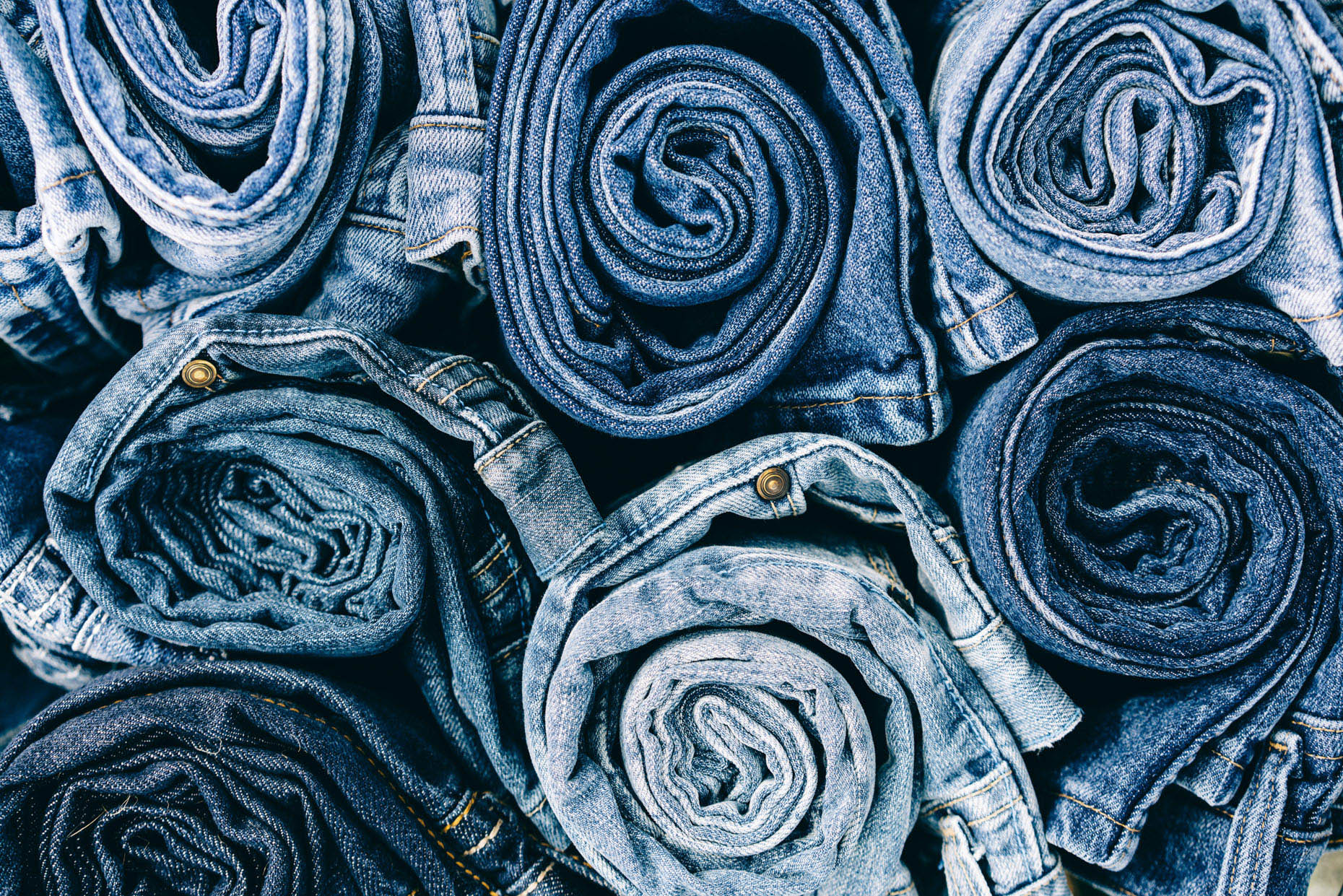 Close up of stack of rolled up Wrangler denim jeans