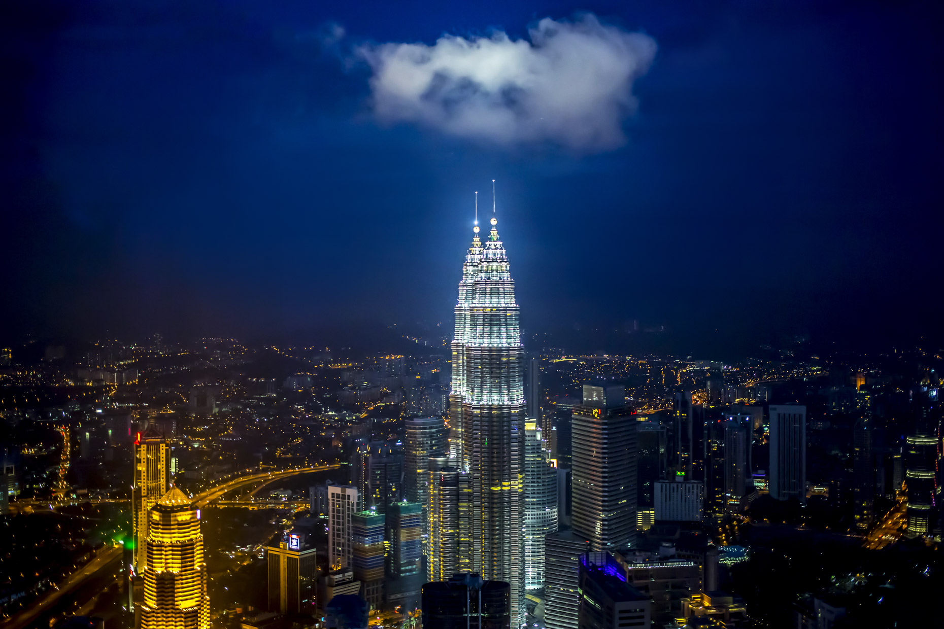 Cloud over Petronas Towers at night in Kuala Lumpur