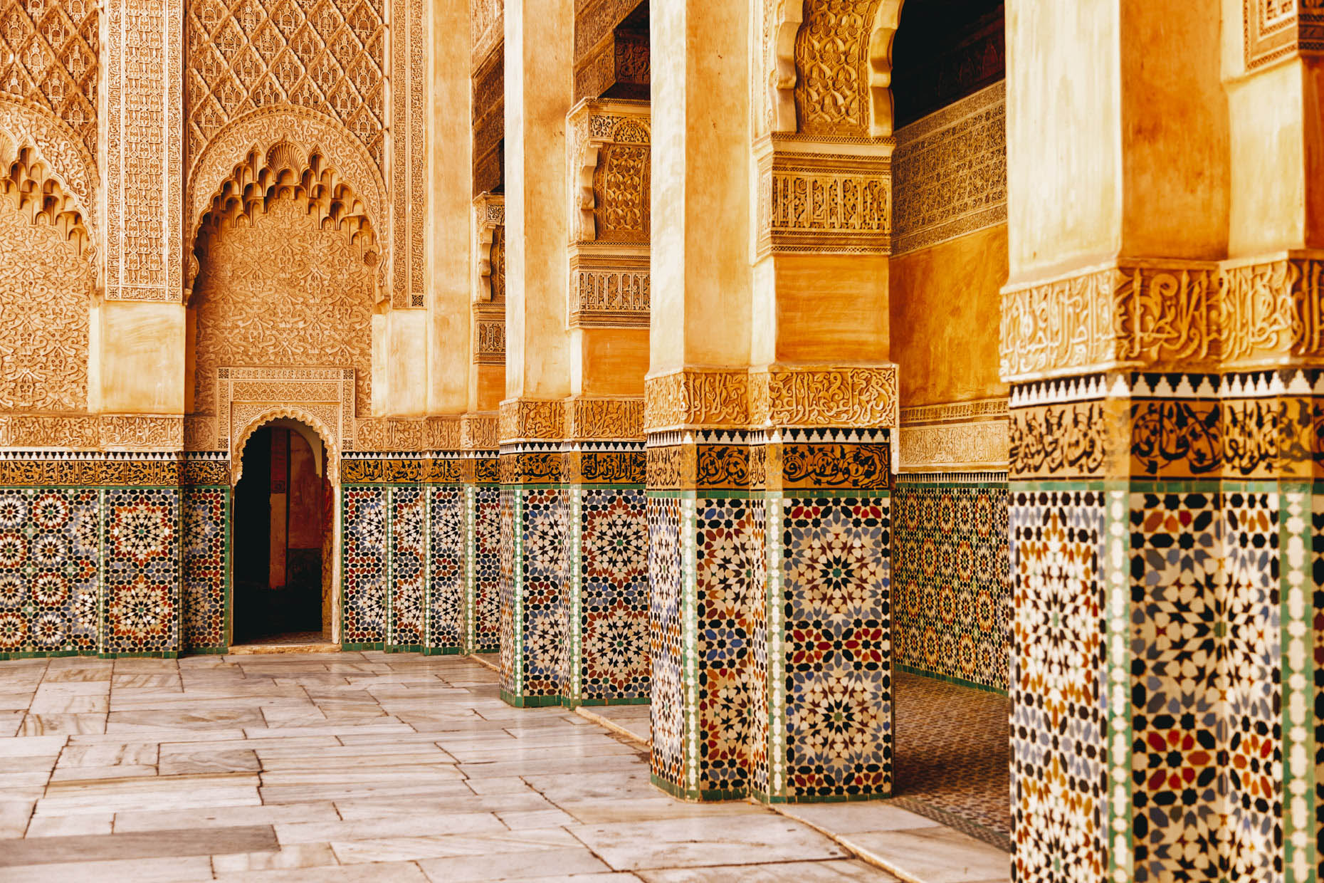 Colorfuly tiled Ben Youssef Madrasa college courtyard in Marrakesh Morocco