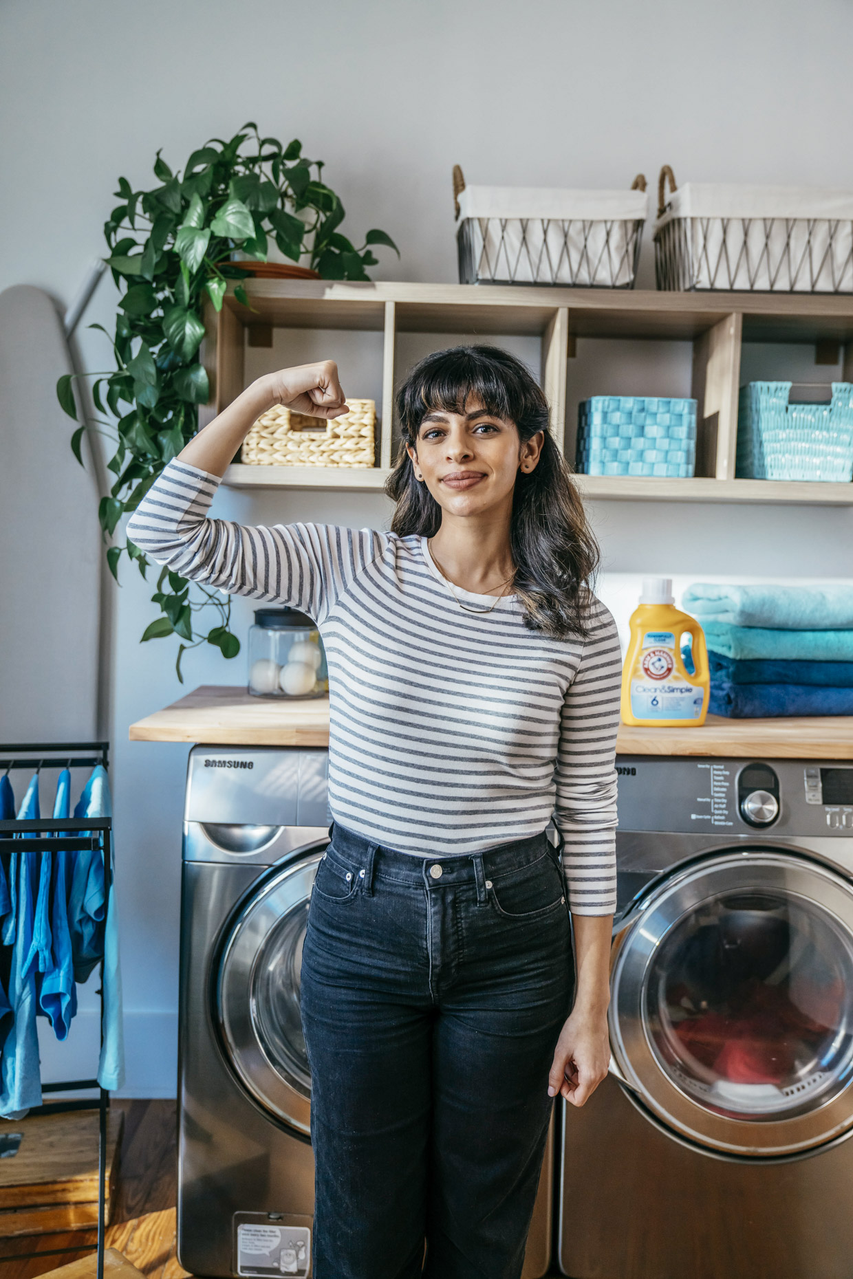 Confident woman with arm raised for Arm and Hammer Laundry detergent