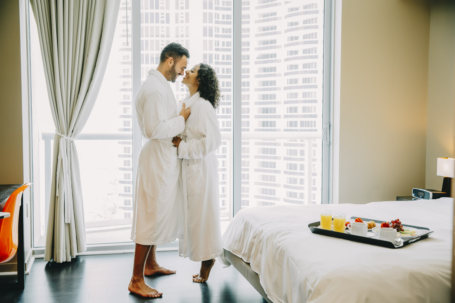 Couple-in-hotel-robes-embracing-smiling-room-service-Inti-St-Clair-is201504251251