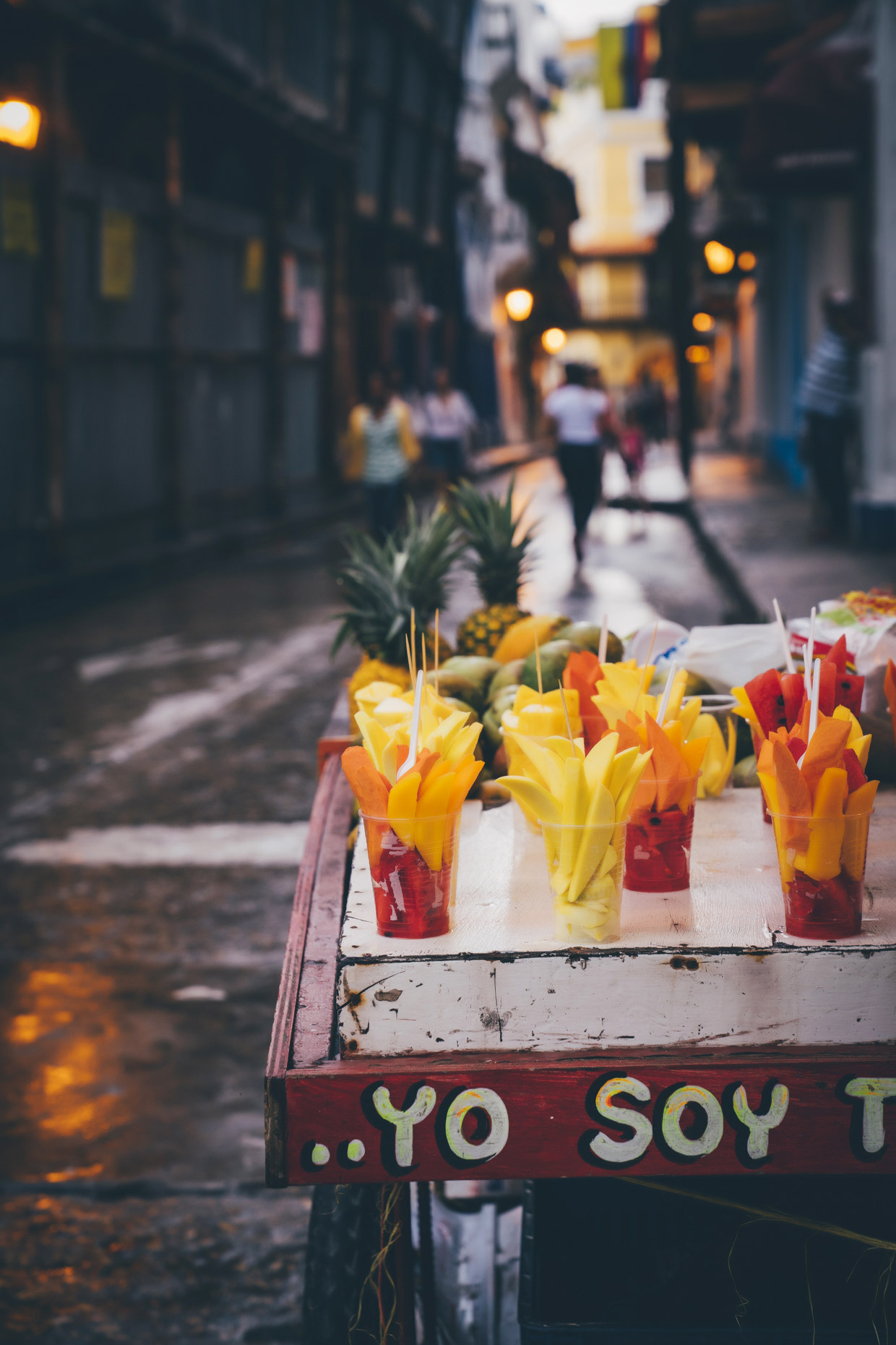 Fresh cut fruit on street cart at night in Cartagena, Colombia