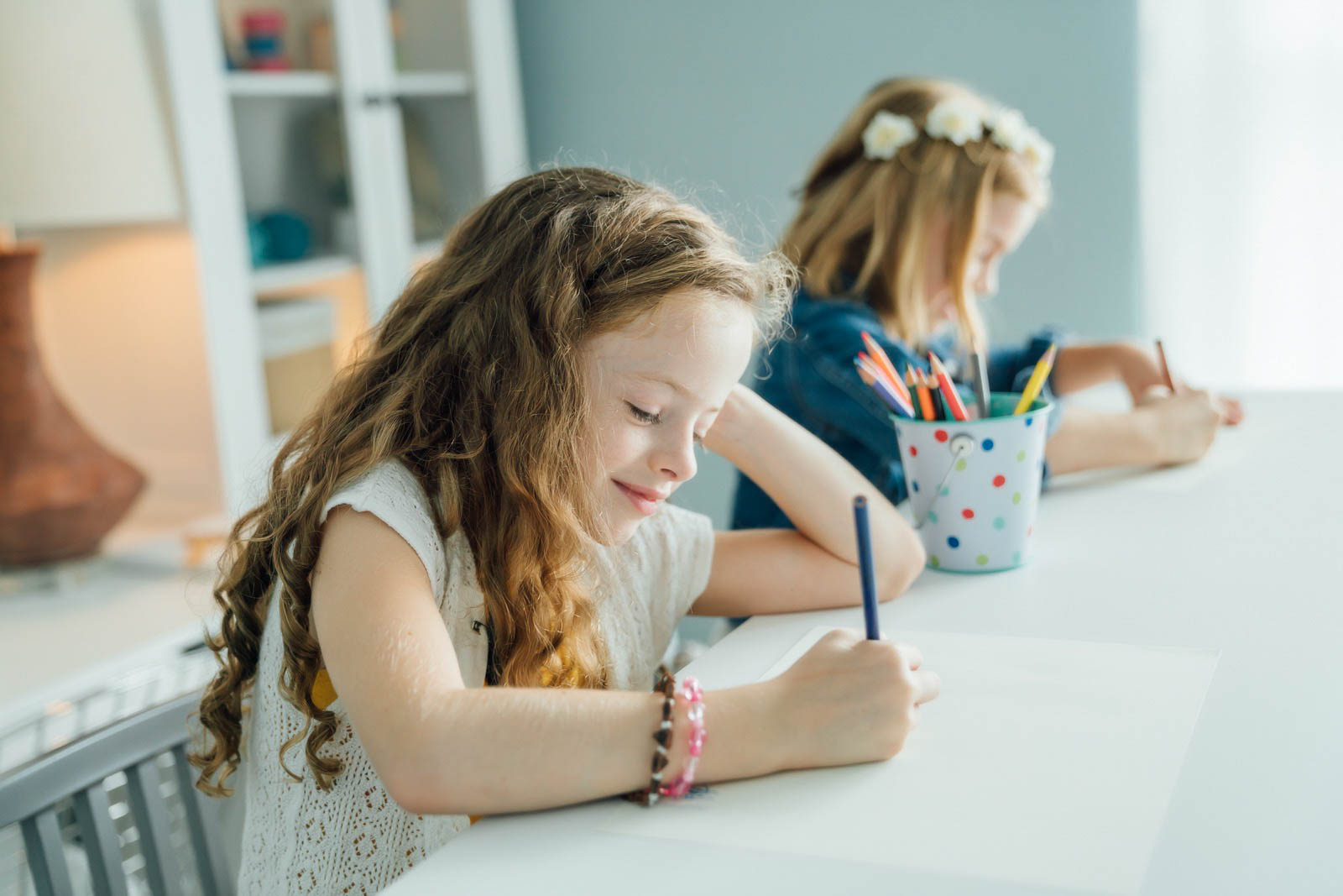 Inti St Clair photo of girls drawing with colored pencils