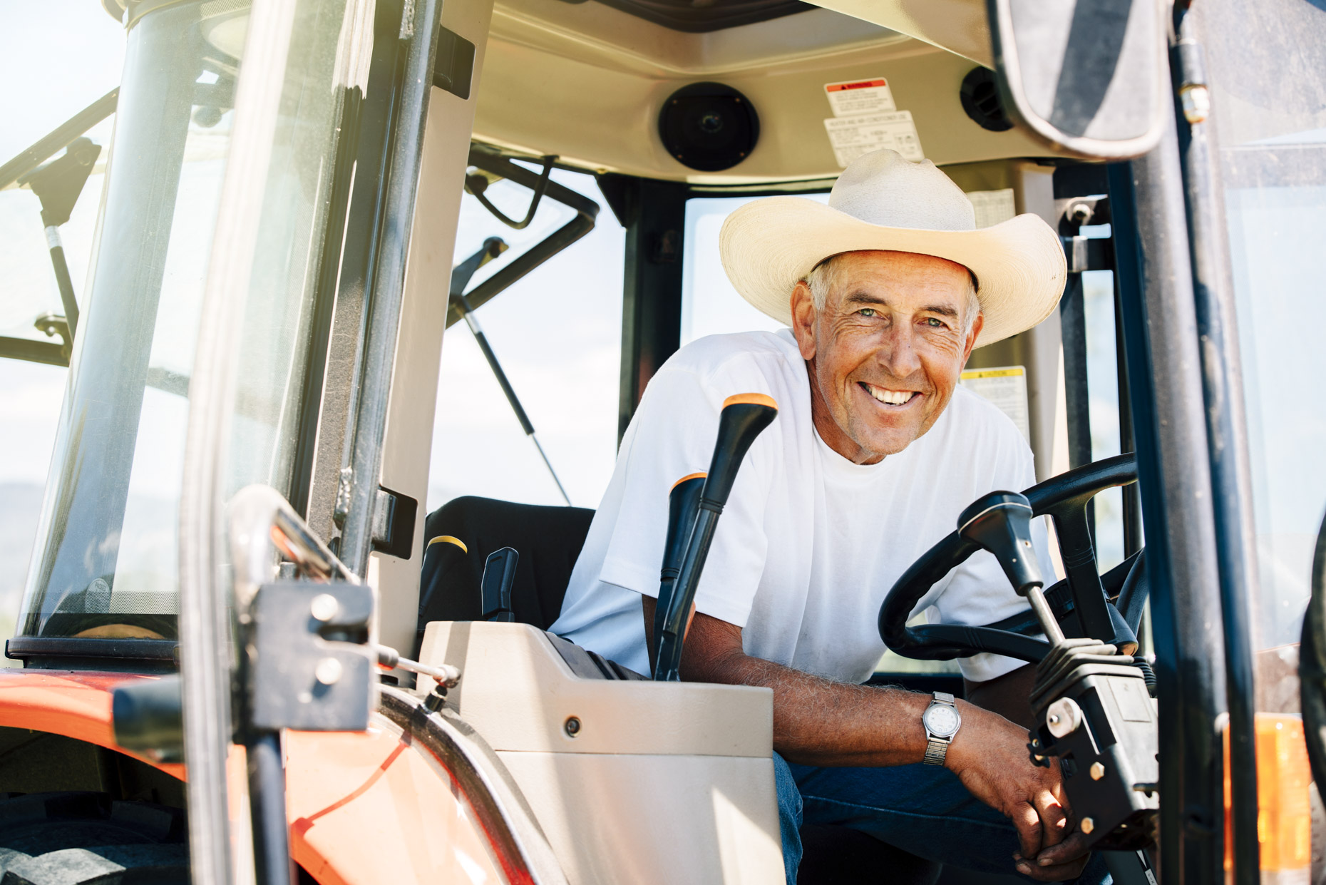 Handsome-smiling-senior-cowboy-in-tractor-is201607241213