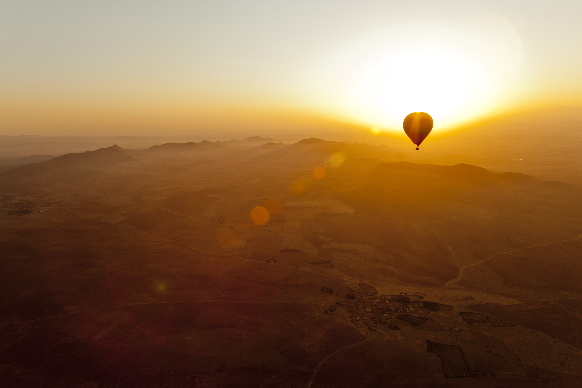 Inti St Clair photo of hot air balloons at sunrise over Moroccan desert