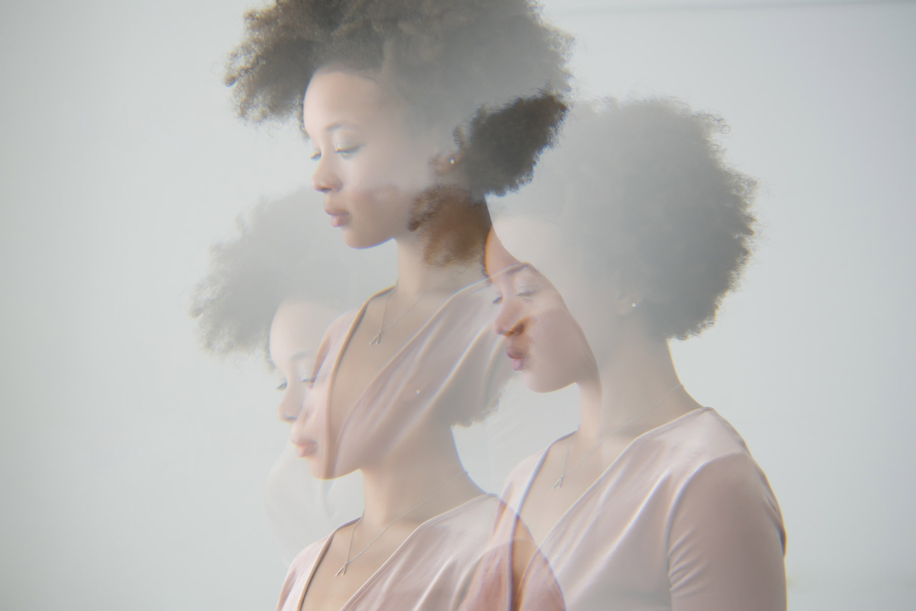 Multiple exposure profile portrait of woman with afro