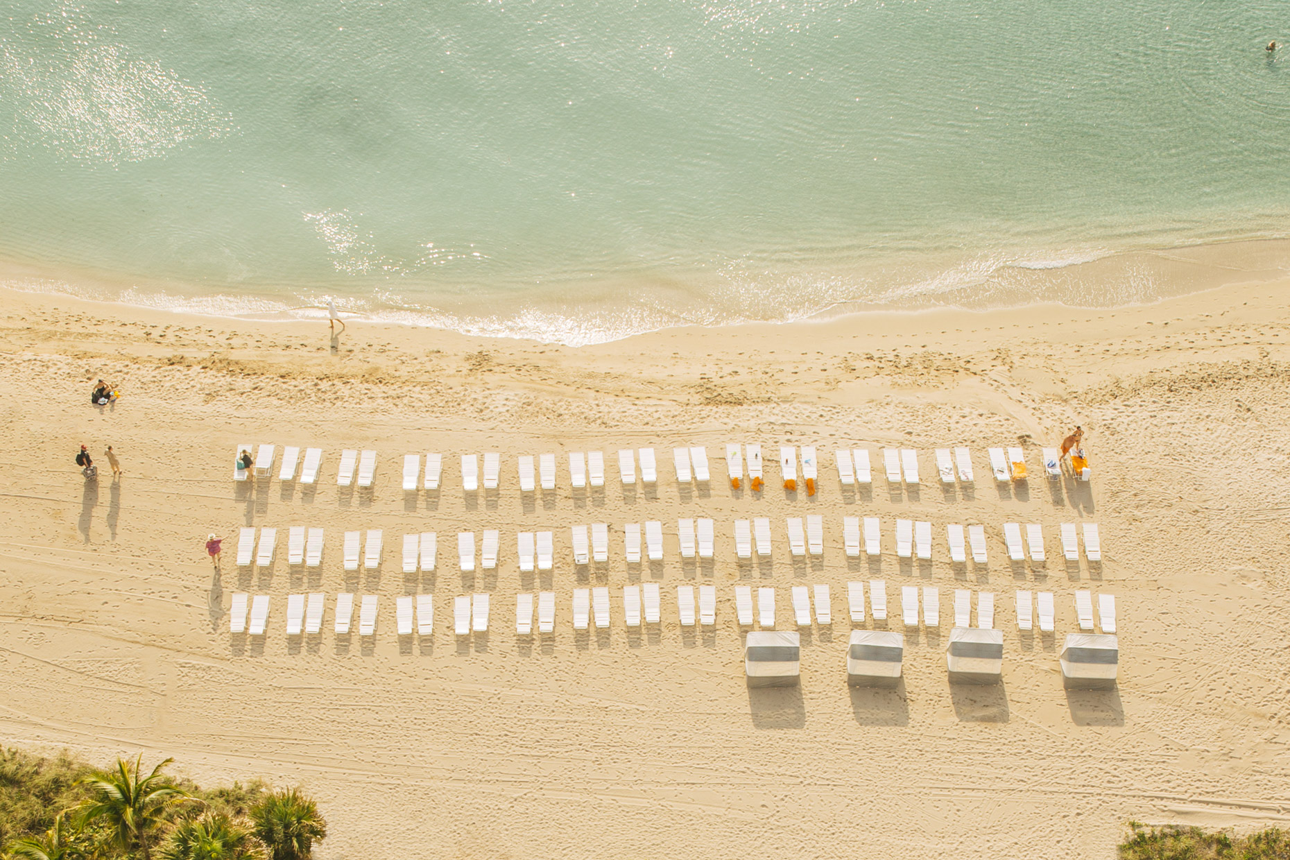 Overhead view of hotel resort chairs by beach and ocean