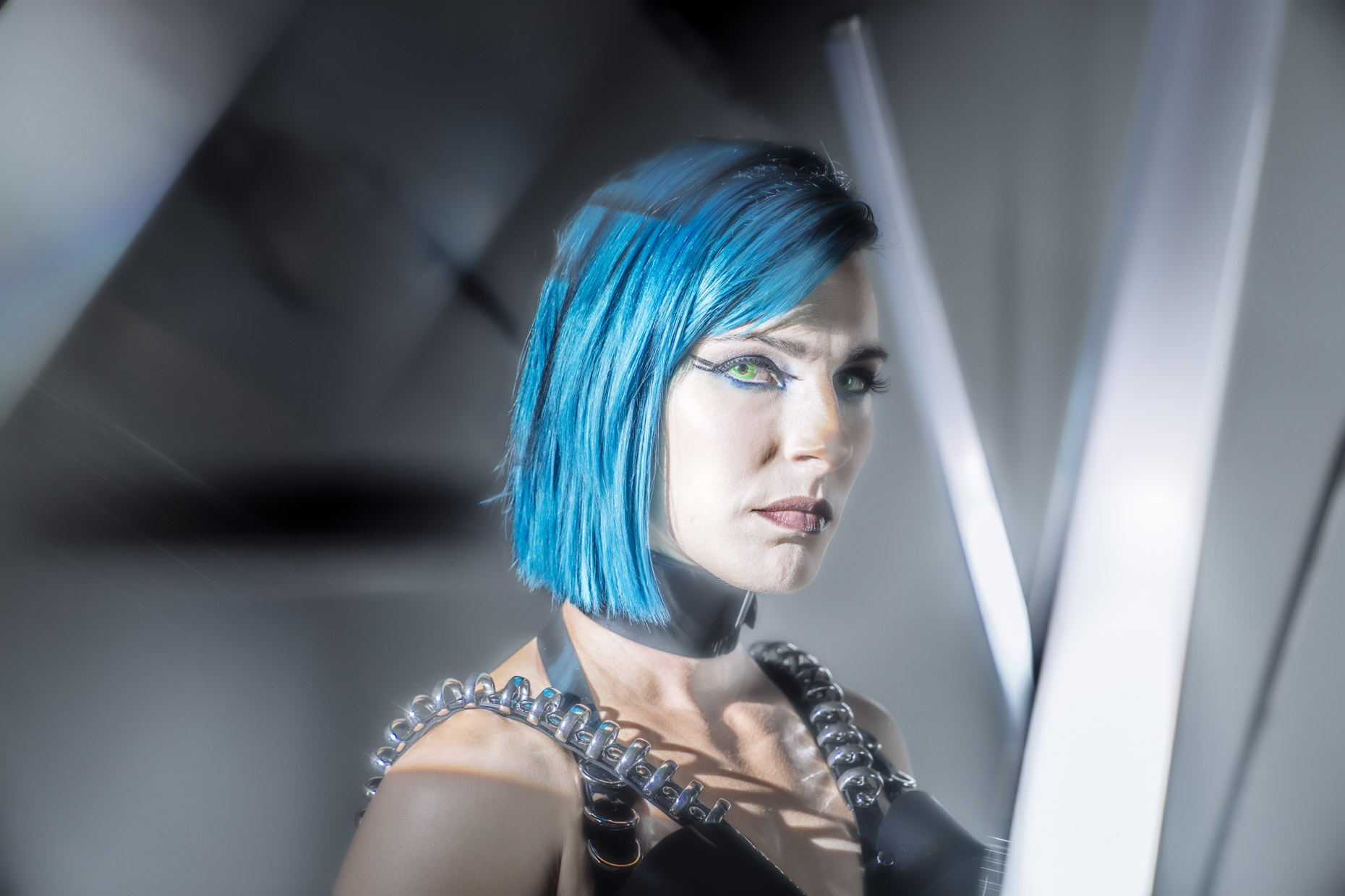 Portrait of cyber punk musician Le Destroy with blue hair