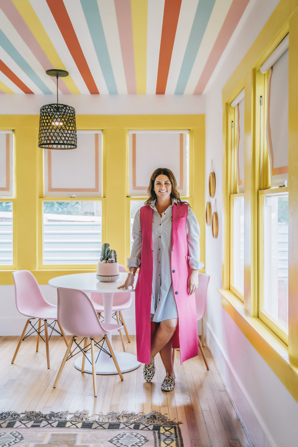 Portrait of textile designer Katie Kime in office with rainbow pink, yellow, blue paint