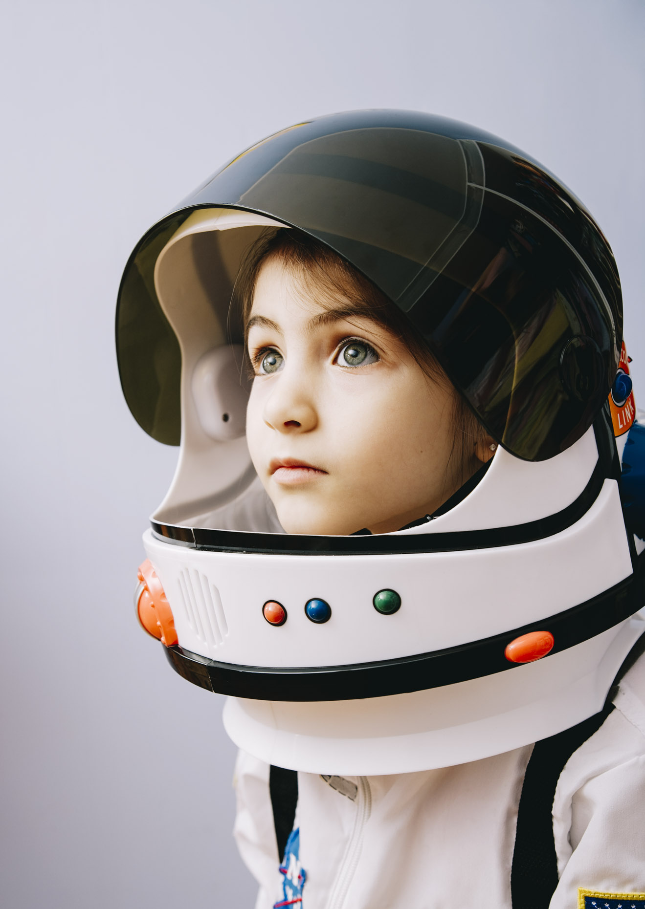 Portrait of young girl in space suit, Seattle, WA, Inti St. Clair