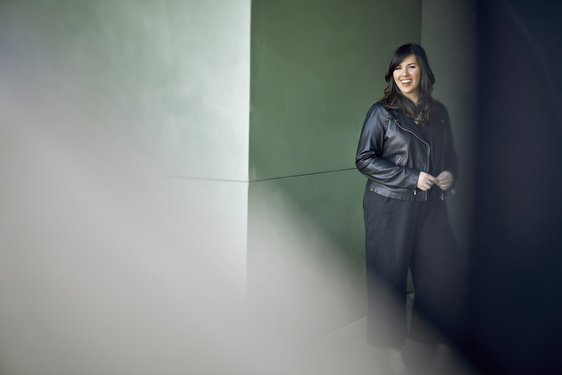 Portrait of smiling woman in black leather coat