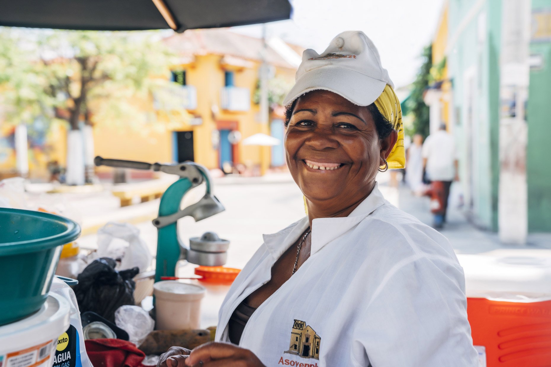 Portrait of smiling woman at street food cart in Cartagena, Colombia