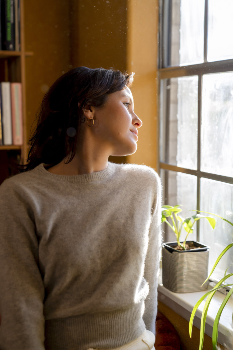Profile of woman looking out window