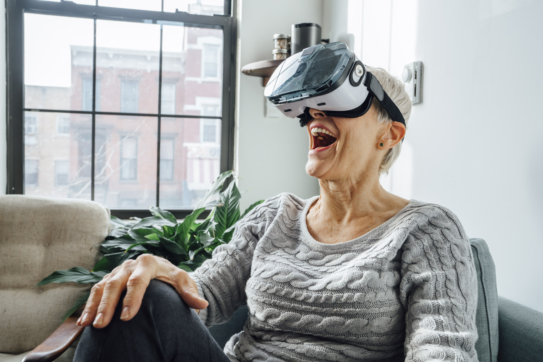 Senior woman excited about virtual reality glasses