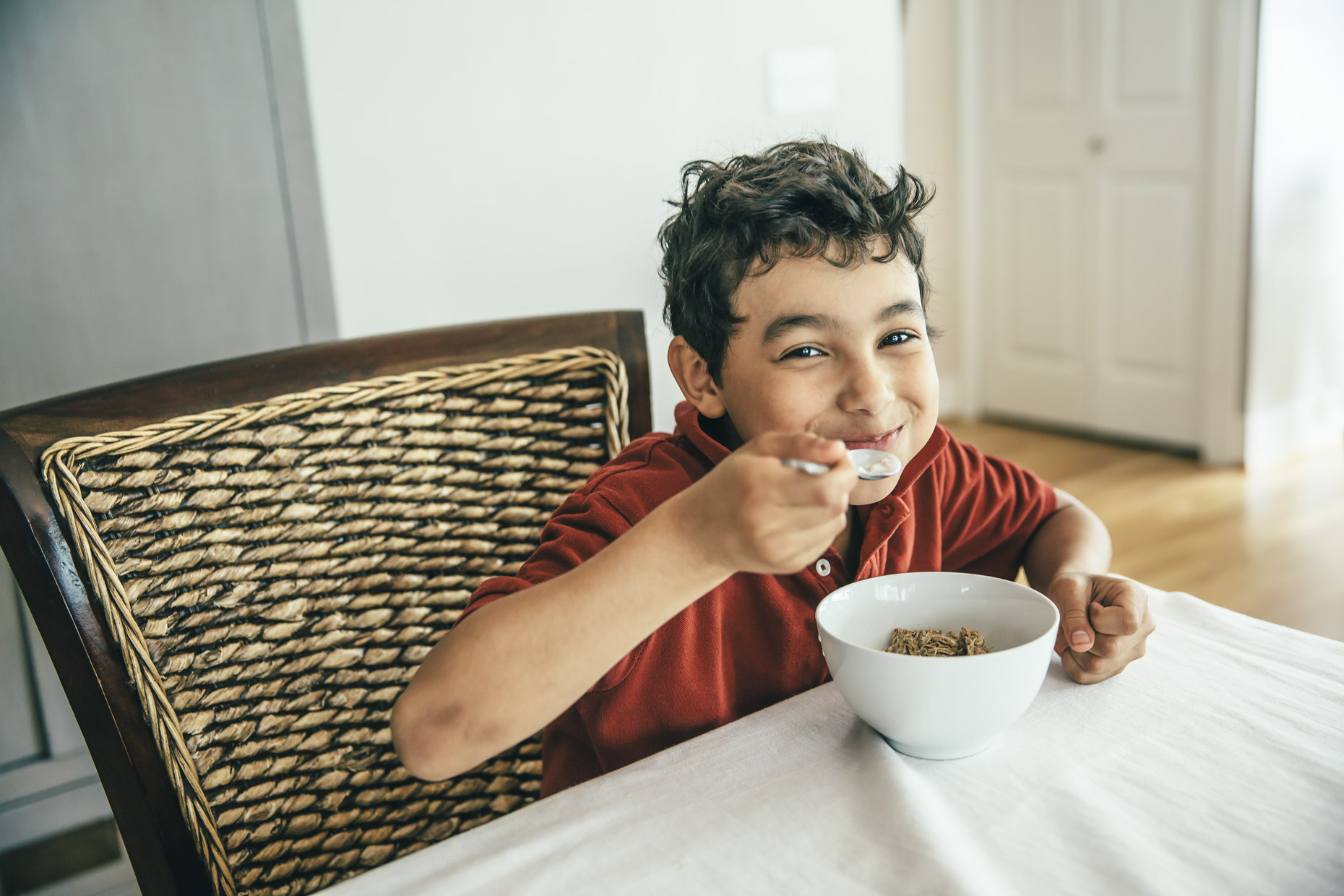 Smiling boy eating cereal