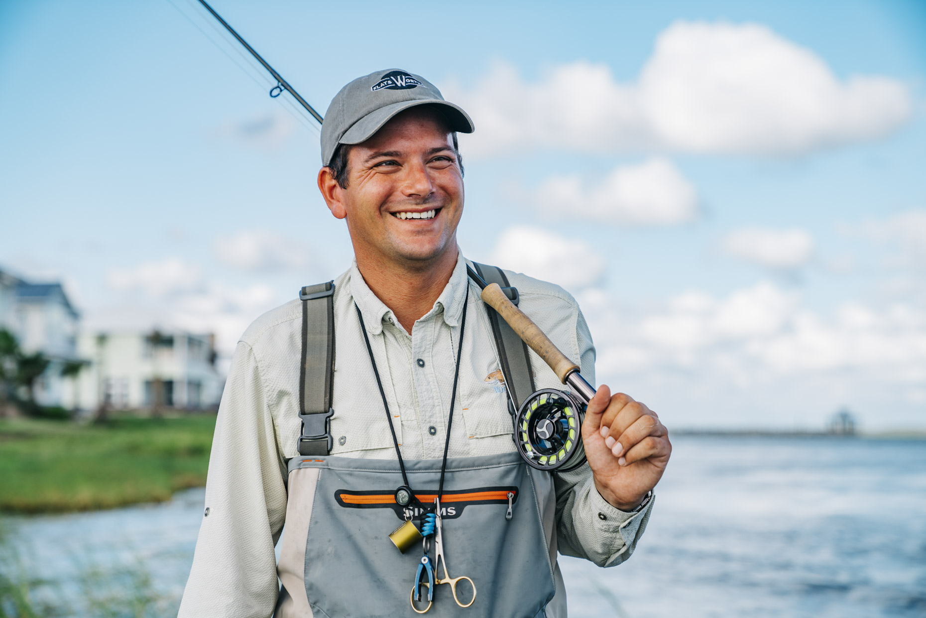 Smiling man in fly fishing gear