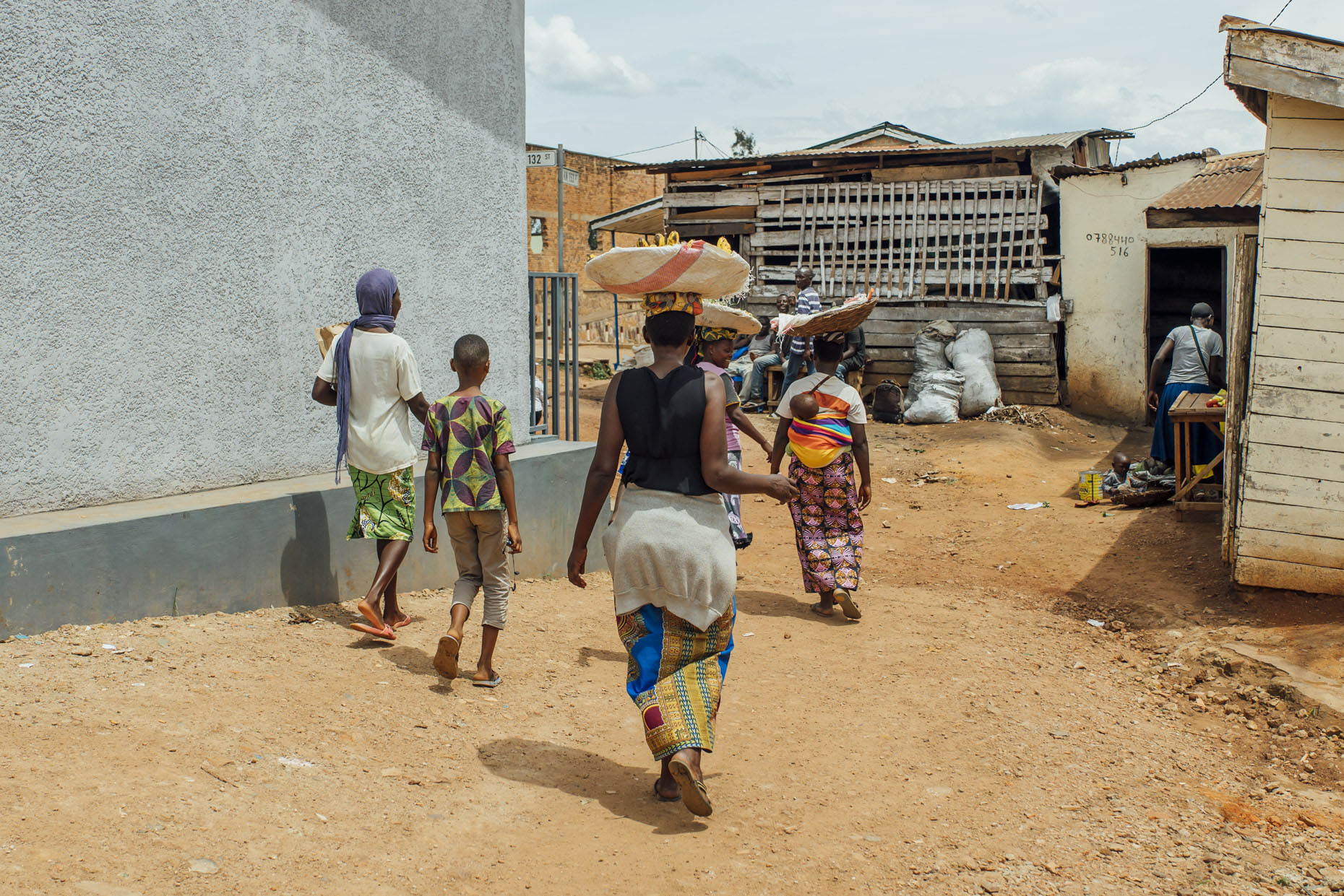 Street scene in Kigali Rwands with women carrying fruit in baskets on head