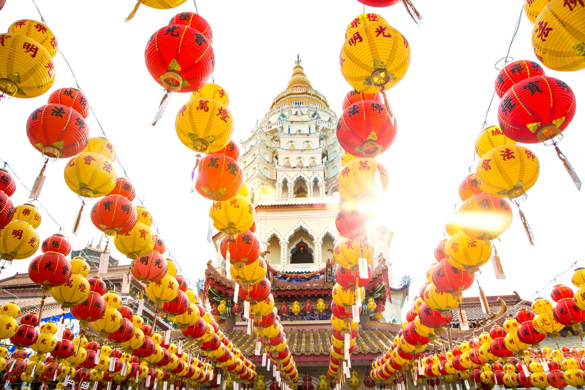 Temple with strings of yellow and red lanterns for Chinese New Year celebrations