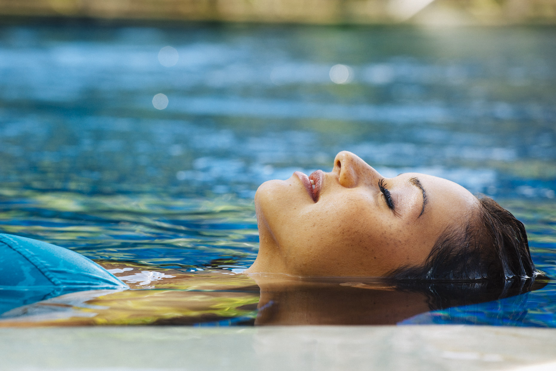 Woman floating in hotel resort pool