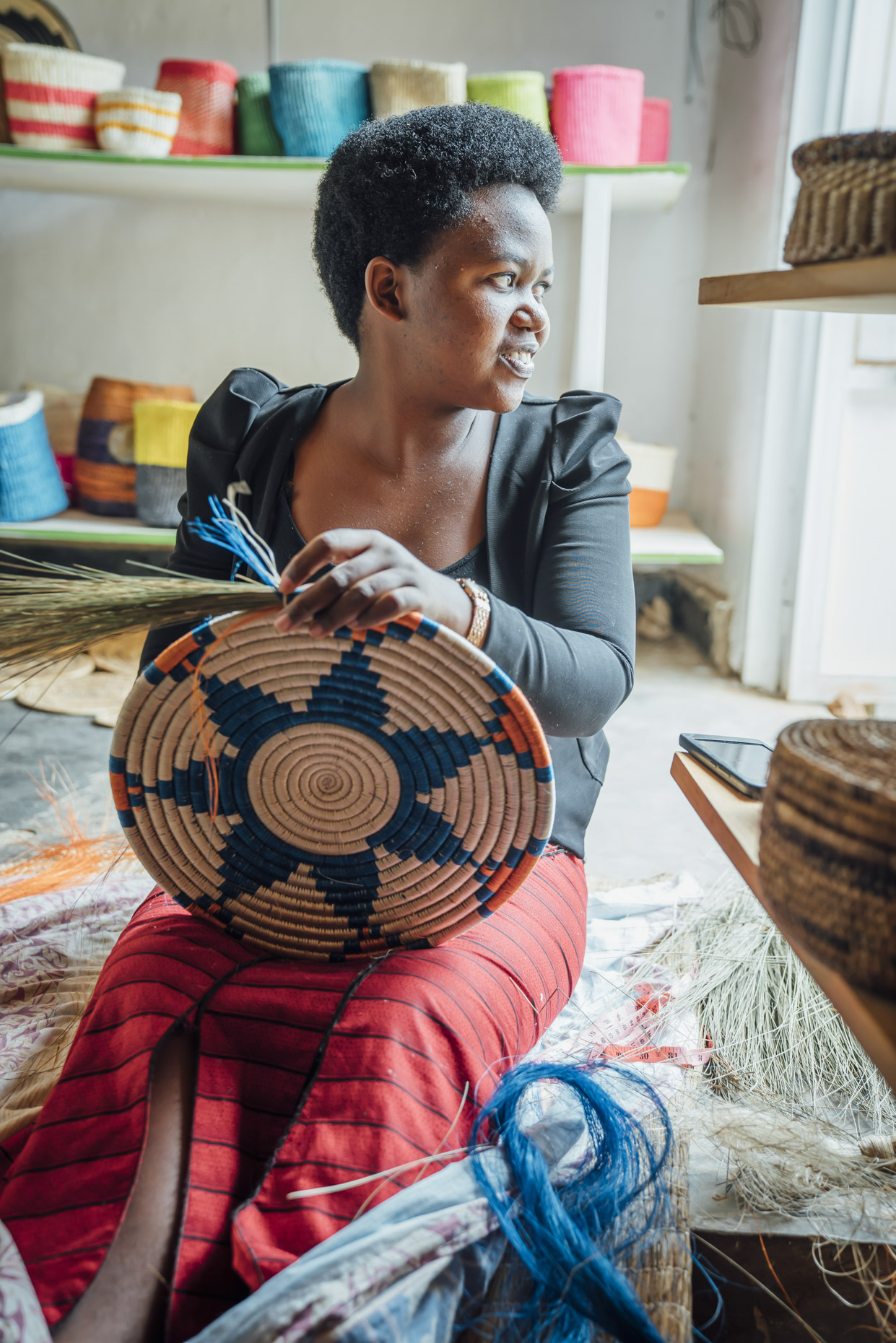 Inti St Clair photo of woman hand crafting grass basket in Kigali Rwanda