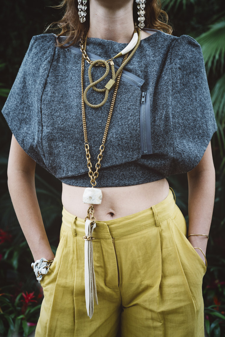 Woman wearing long brass leather stone necklace