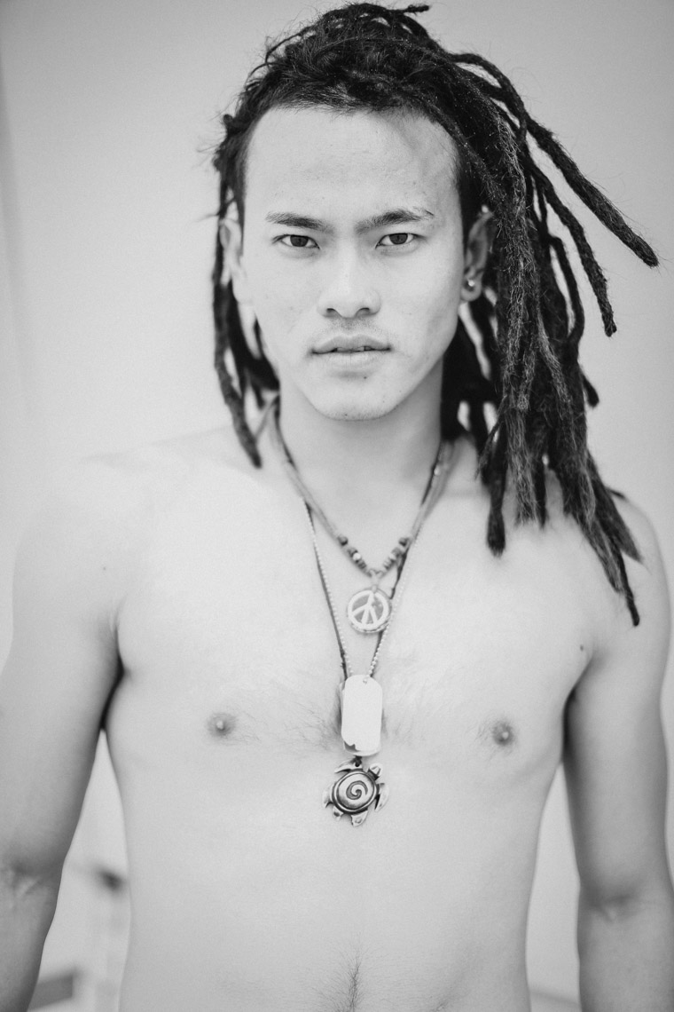 black-white-portrait-of-shirtless-asian-man-dreadlocks-necklaces-is201203281198