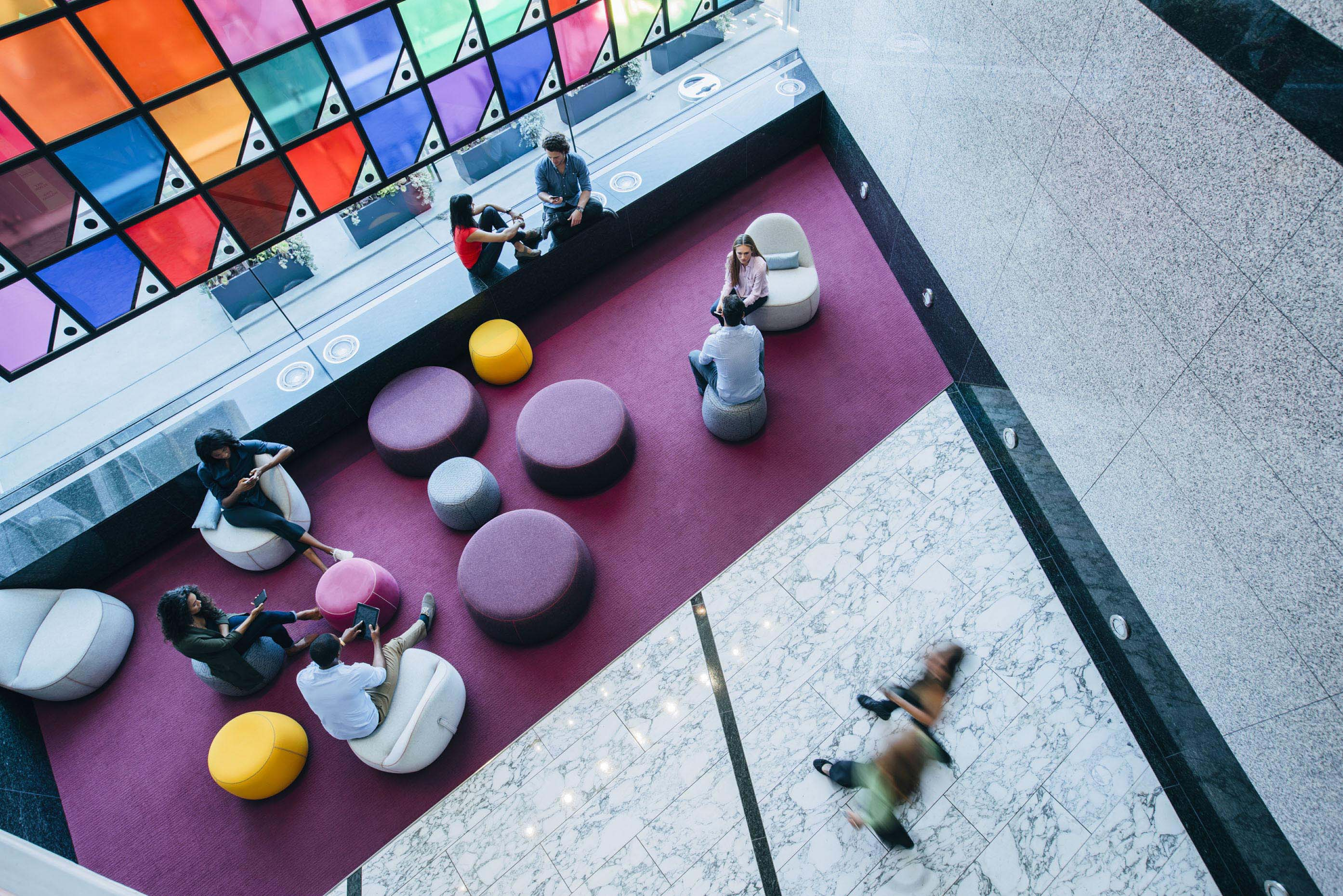 overhead-view-modern-bright-colorful-office-lobby-Inti-St-Clair-is201707224056